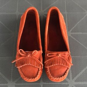 Orange Minnetonka moccasins size 7